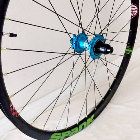 custom mountain bike wheel with Project 321 hub and Spank Rim